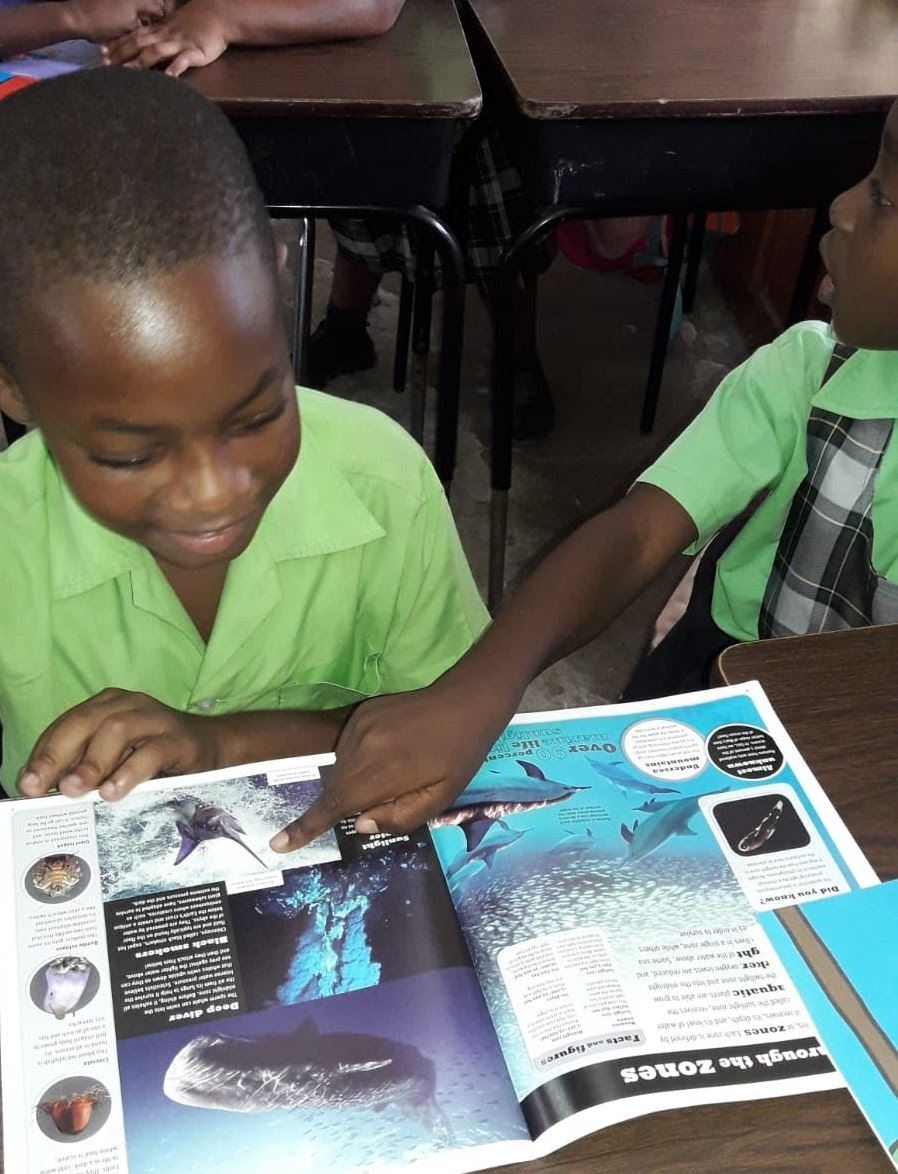 Student in St. Kitts receives new book